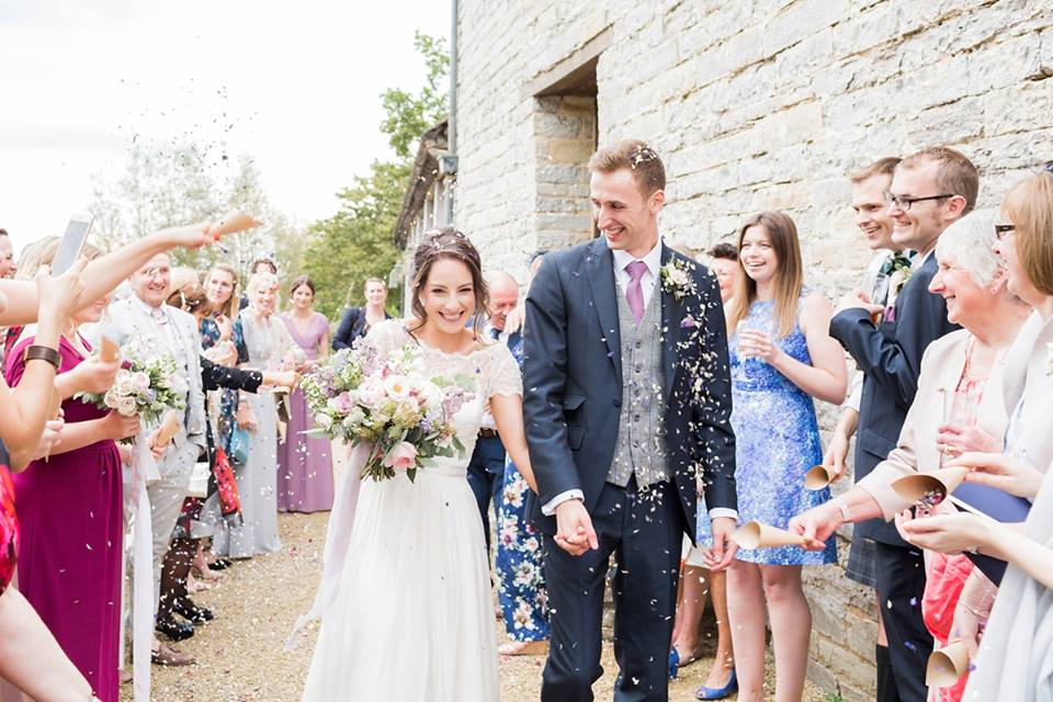 Natural petal throwing confetti wedding moment